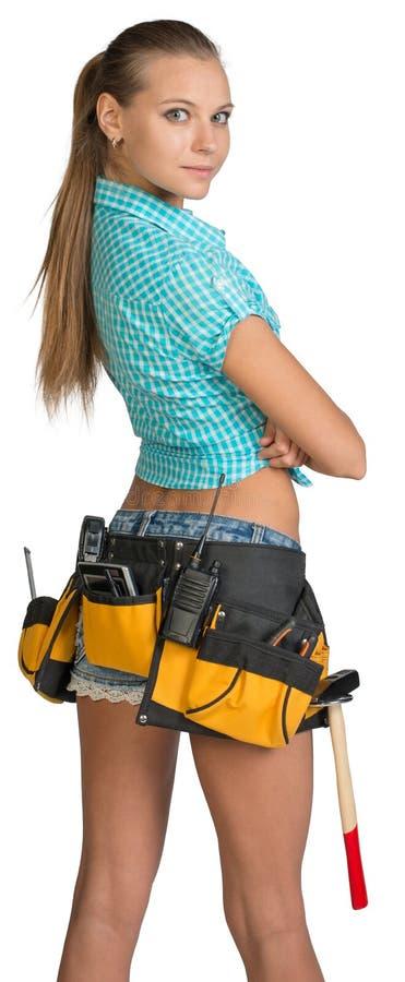 俏丽的女孩简而言之、衬衣和工具传送带与 库存图片