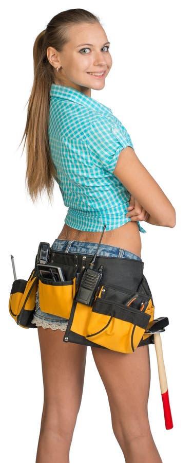 俏丽的女孩简而言之、衬衣和工具传送带与 库存照片
