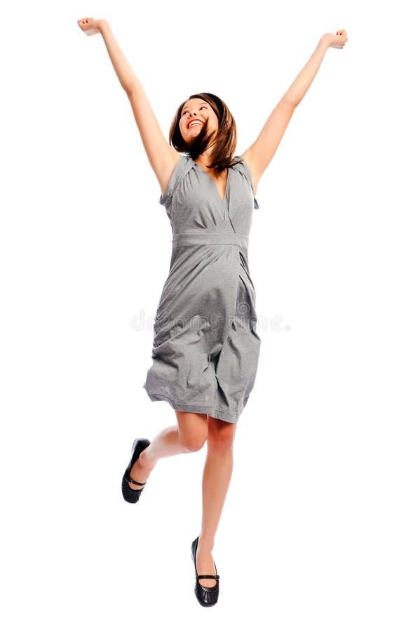 俏丽的女孩跳与她的胳膊 库存图片