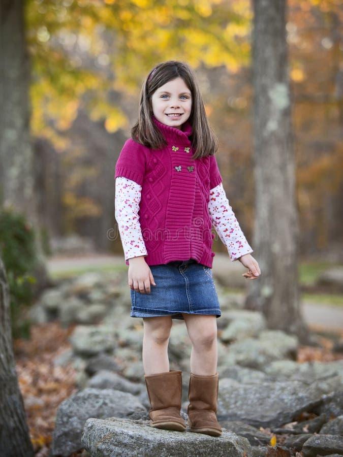 俏丽的女孩画象在公园 库存照片