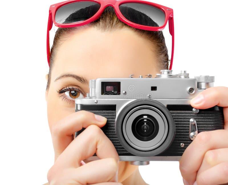 俏丽的妇女摄影师 免版税库存照片