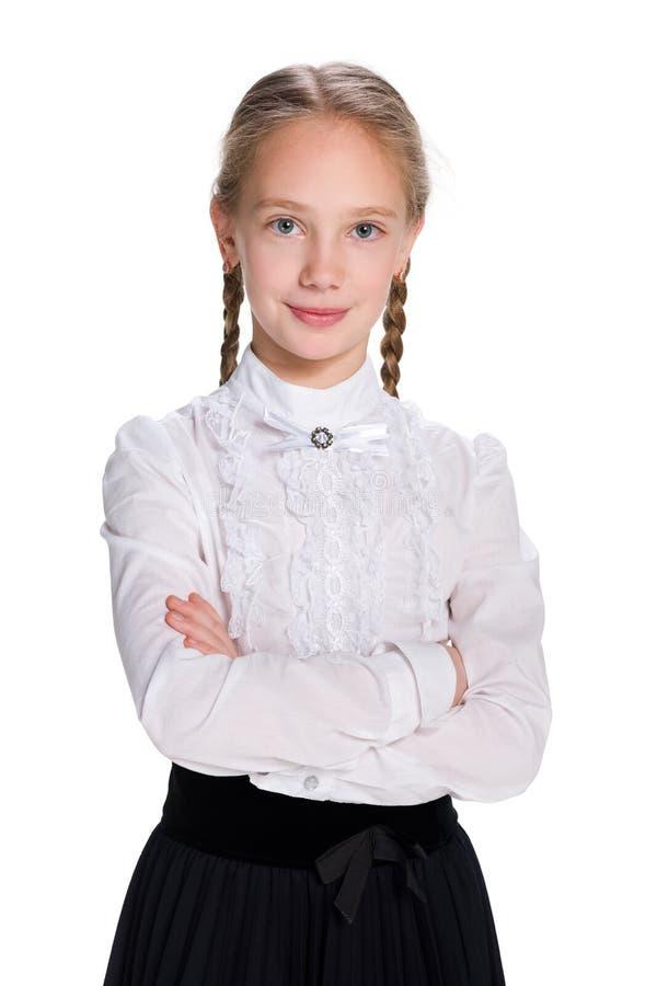 俏丽的微笑的女小学生 免版税库存图片