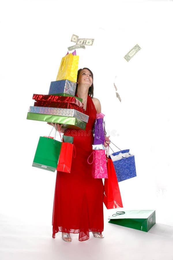 俏丽的购物妇女年轻人 免版税库存图片