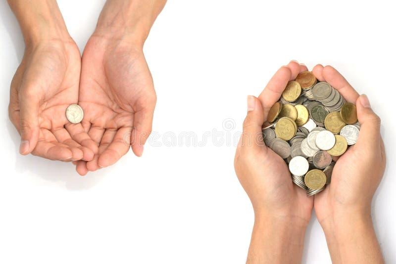 保存金钱概念用拿着硬币的手在白色背景 免版税库存图片