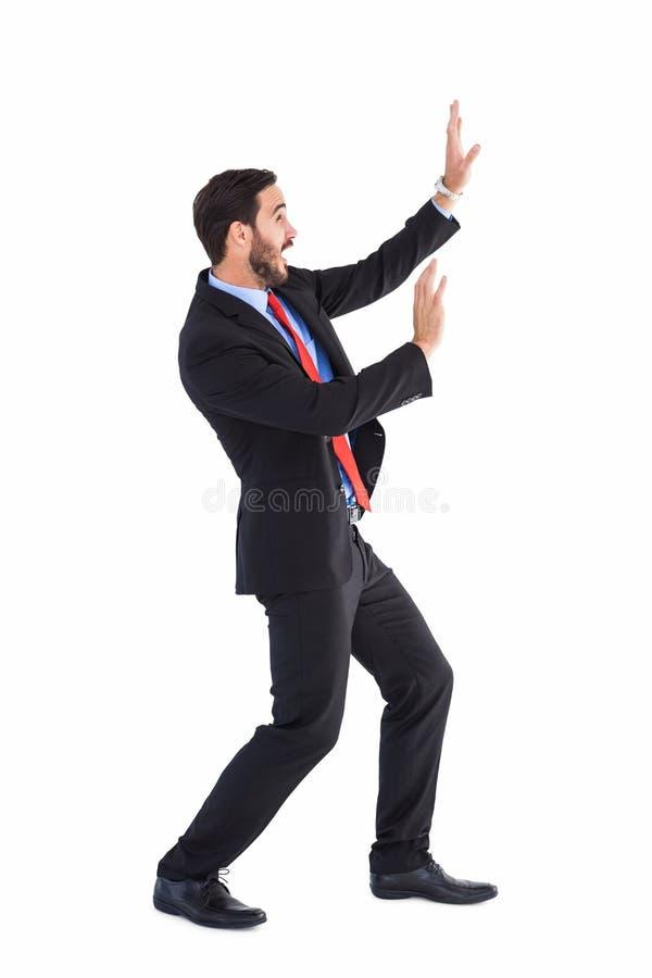 保护自己的震惊商人用这些手 免版税图库摄影