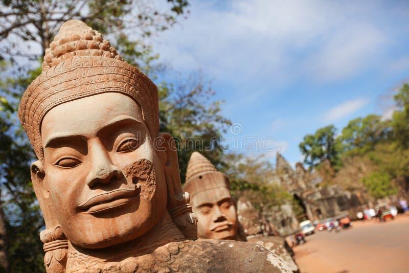 保护Bayon寺庙, Angko的石表面战士 免版税库存照片
