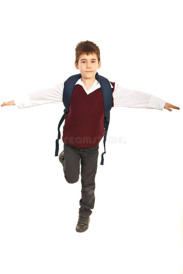 保持平衡的学员男孩 免版税库存照片