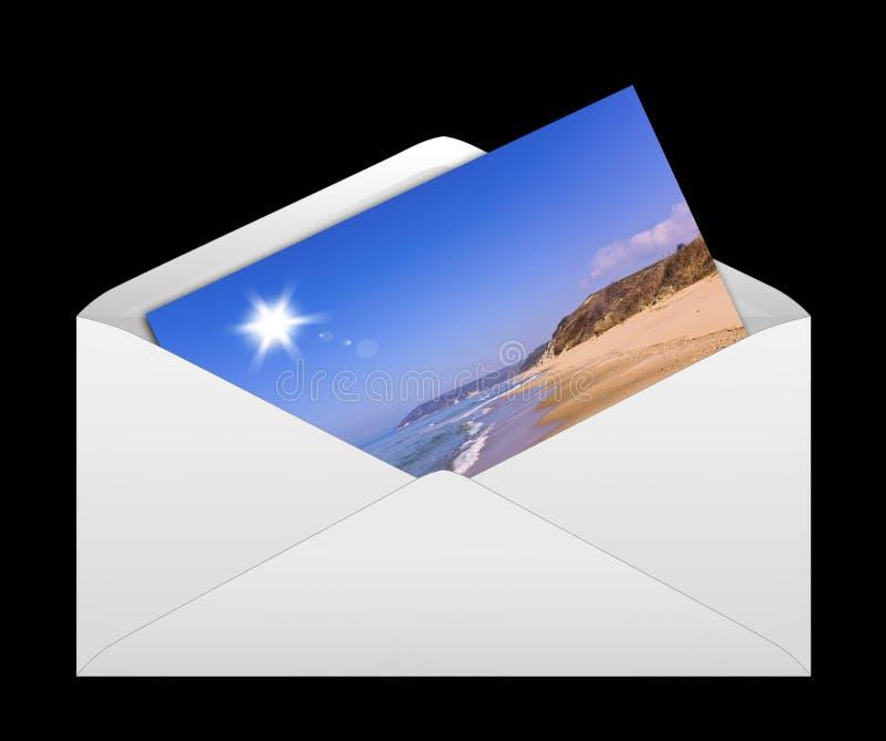 与照片卡片的信封 免版税库存图片