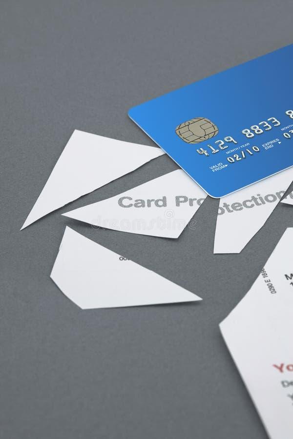 信用卡保护政策切开了成与信用卡的片断 库存图片