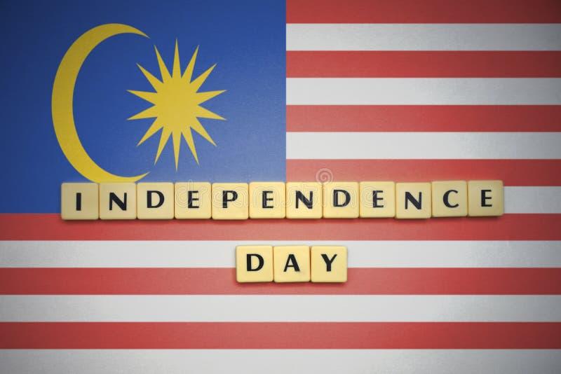 信件与文本在马来西亚的国旗的独立日 免版税库存照片