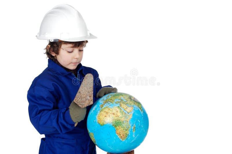 修建将来的世界的可爱的建造者 库存照片