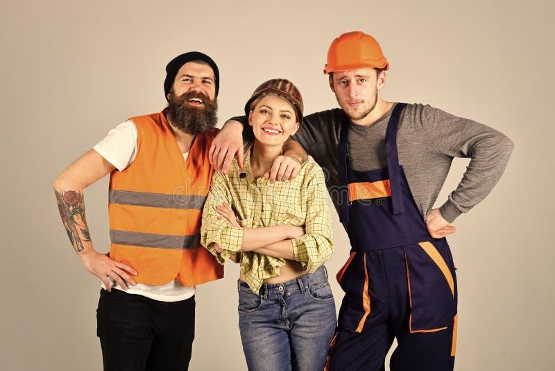 修理旅团概念 配合,服务周到,旅团 快乐的工作者公司,建造者,修理匠,石膏工 人 免版税库存照片