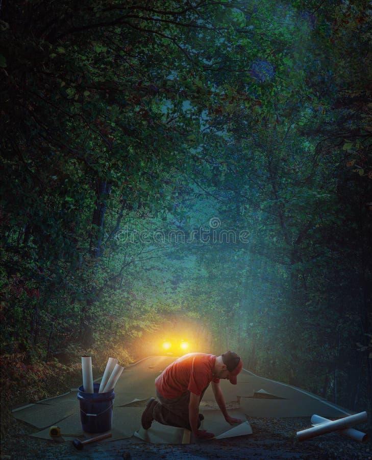 修造一条路在晚上 免版税库存图片