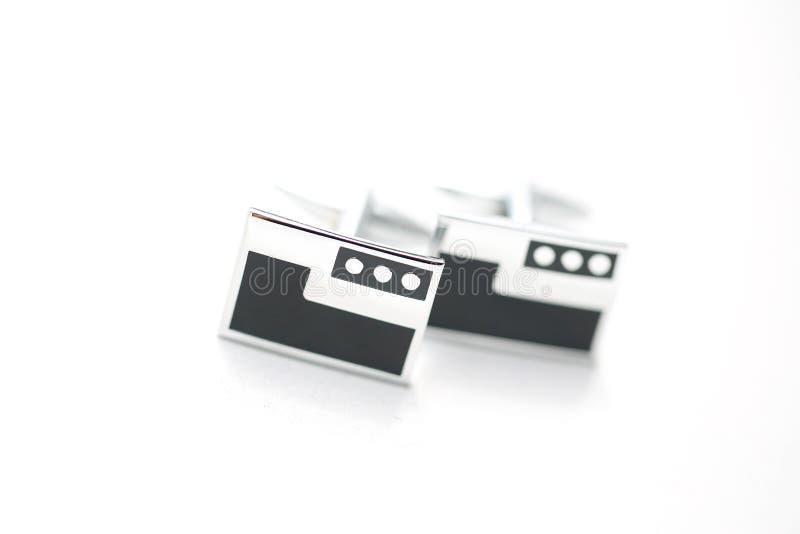 修饰` s在被隔绝的背景的袖扣 库存图片