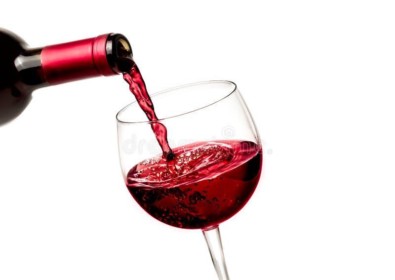 倒在玻璃的男服务员红葡萄酒 图库摄影