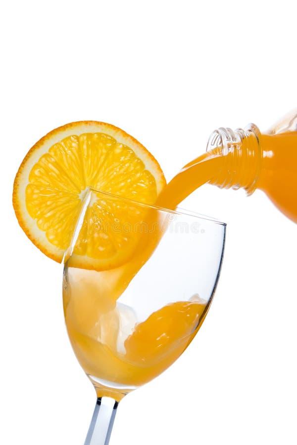 倒的玻璃汁液桔子 图库摄影