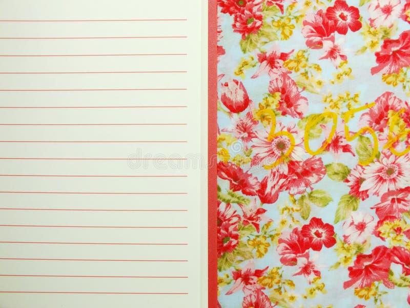 倒空与红线的开放笔记本纸 免版税库存照片