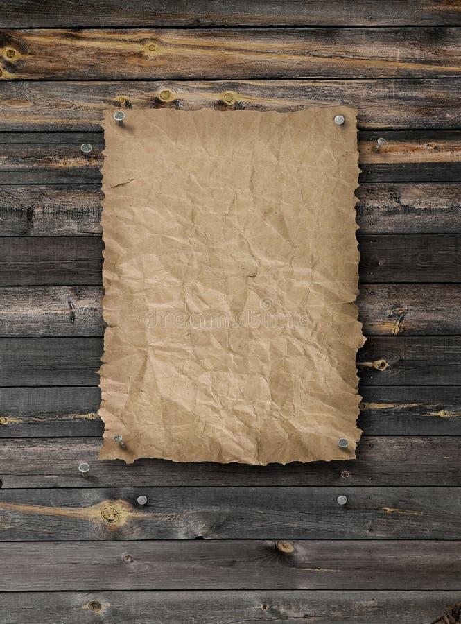 倒空在板条木头墙壁上的被要的海报 免版税库存照片