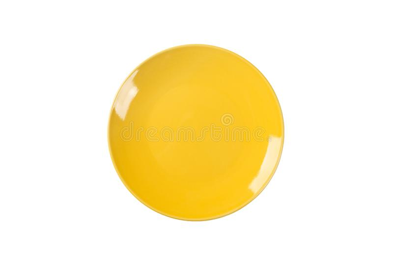 倒空在白色背景隔绝的黄色陶瓷圆的板材 顶视图 库存图片