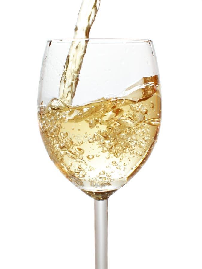 倾吐的白葡萄酒 库存照片