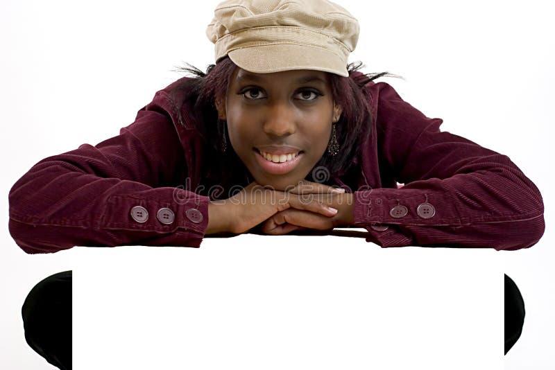 倾斜在符号空间妇女年轻人的黑色空白复制 免版税库存照片