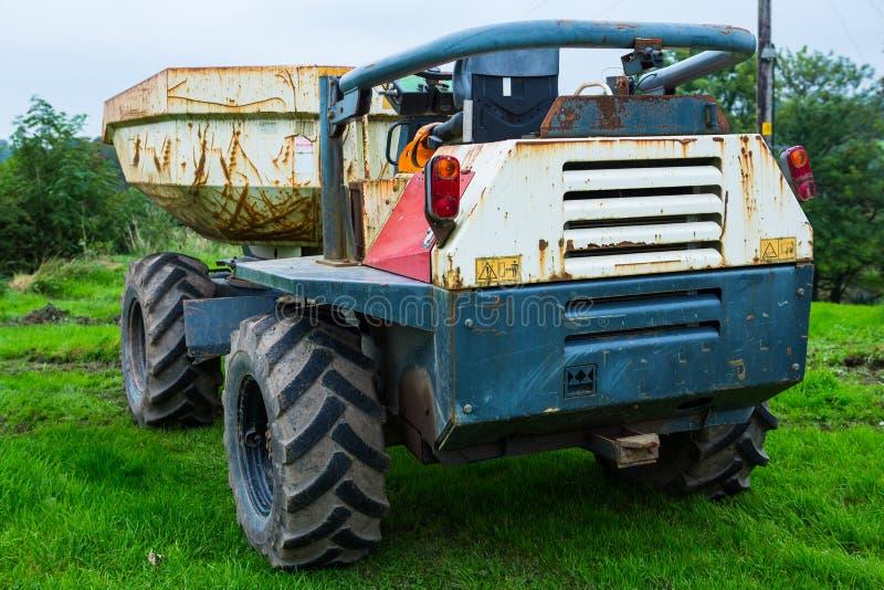 倾销者卡车挖掘机 库存图片