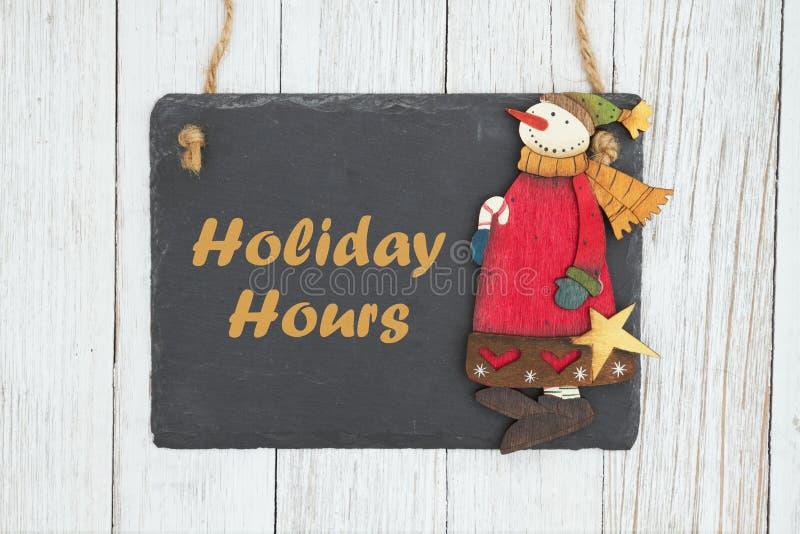 假日小时发短信与有雪人的黑板 免版税库存图片
