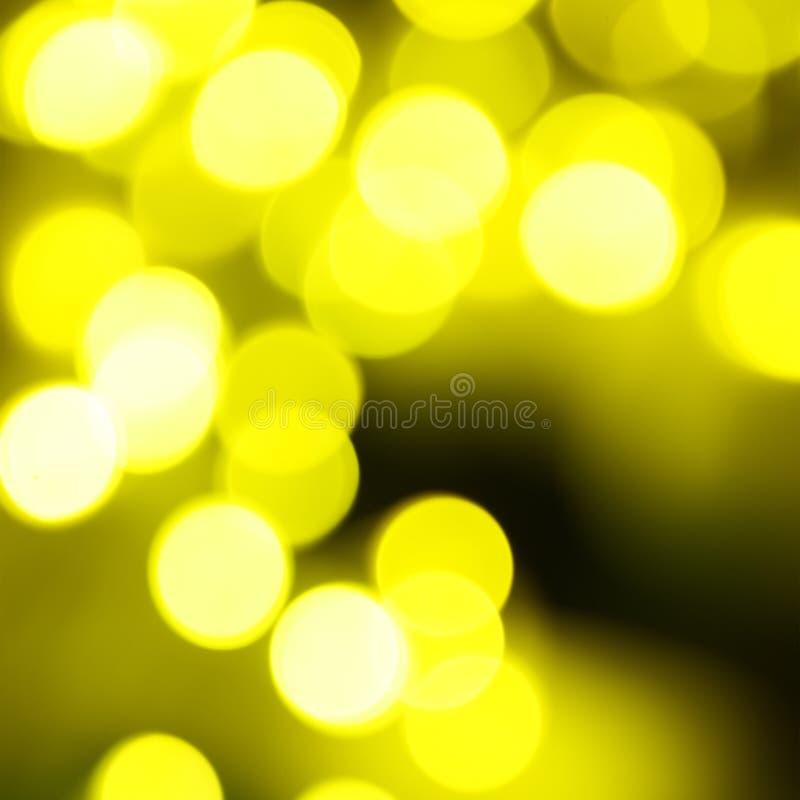 假日抽象绿色和黄灯 免版税库存图片
