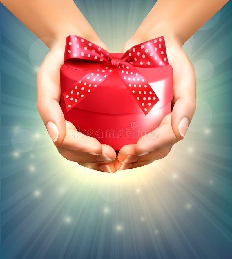 假日背景用拿着礼物盒的手 皇族释放例证