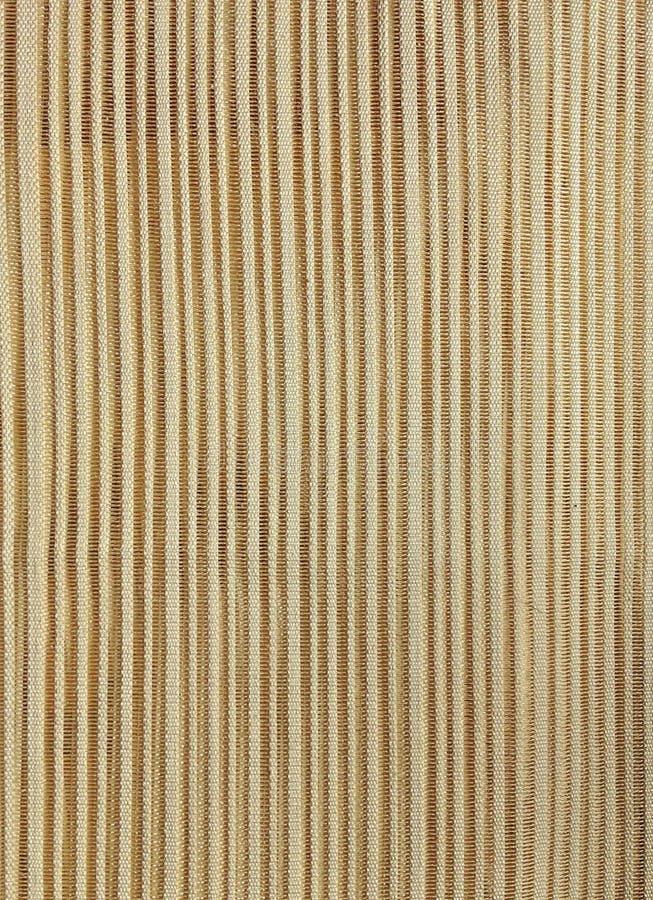 假日金子和米黄纺织品背景 免版税库存图片