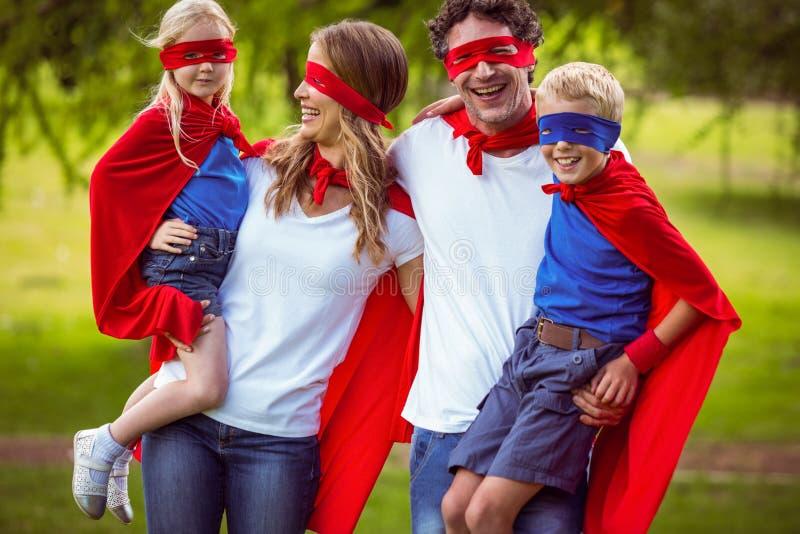 假装愉快的家庭是超级英雄 图库摄影
