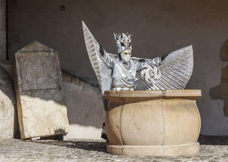 假装的人-阿讷西威尼斯式狂欢节2014年 免版税库存图片