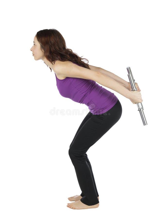 做与重量的健身妇女三头肌佣金在锻炼期间 库存照片