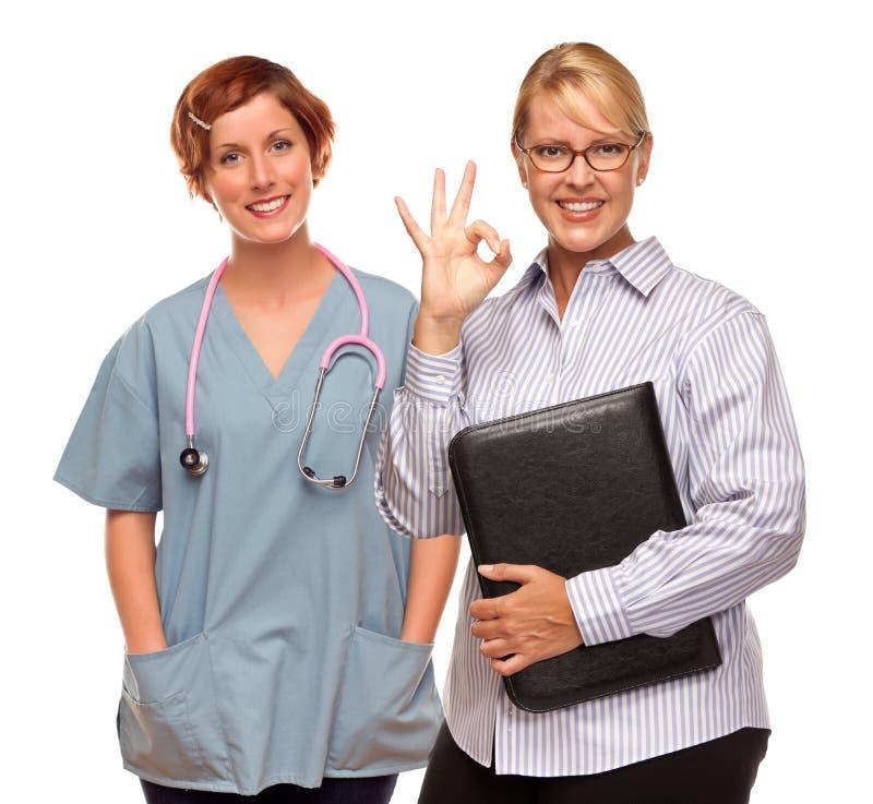 做与医生或护士的女实业家好手标志 免版税库存照片
