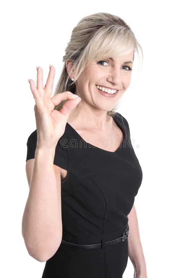 做与finge的迷人的更老的女商人优秀标志 免版税库存照片