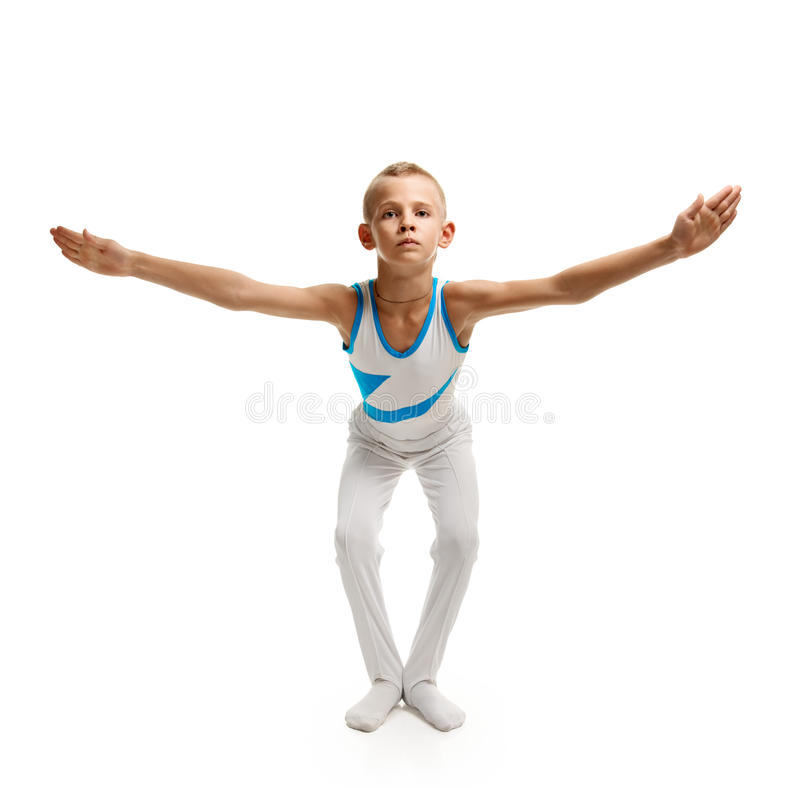 做体操的男孩 库存照片