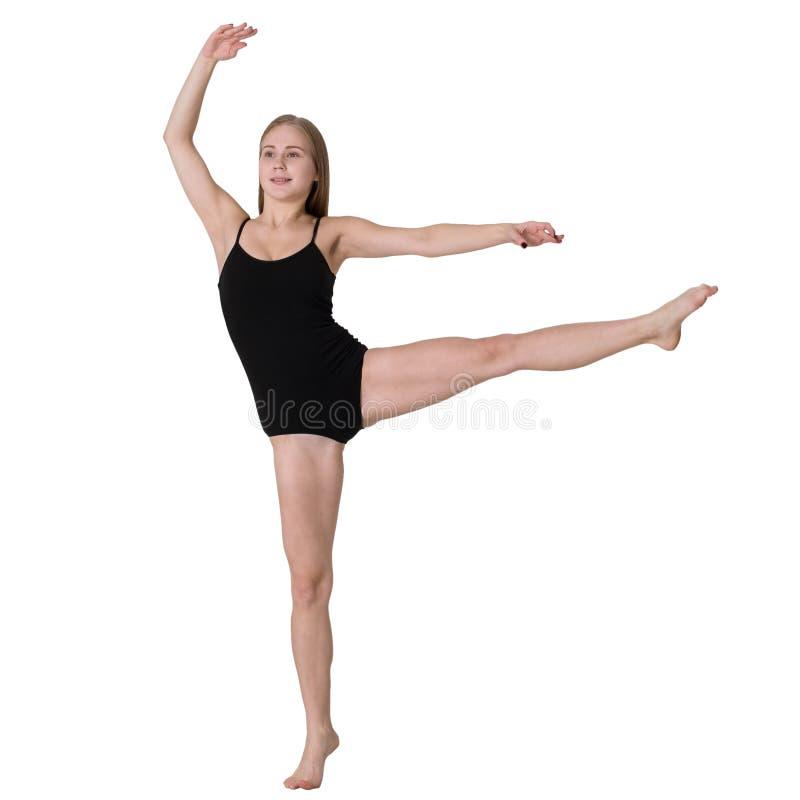 做体操运动的运动的妇女被隔绝 库存图片