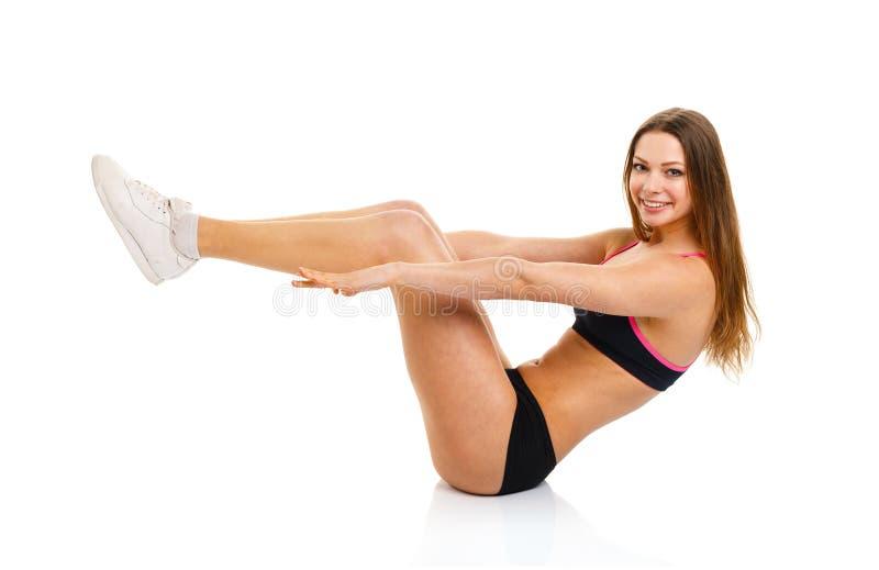 做体育锻炼的愉快的运动妇女,隔绝在白色 库存图片