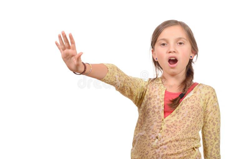 做停车牌用手的女孩 免版税库存图片
