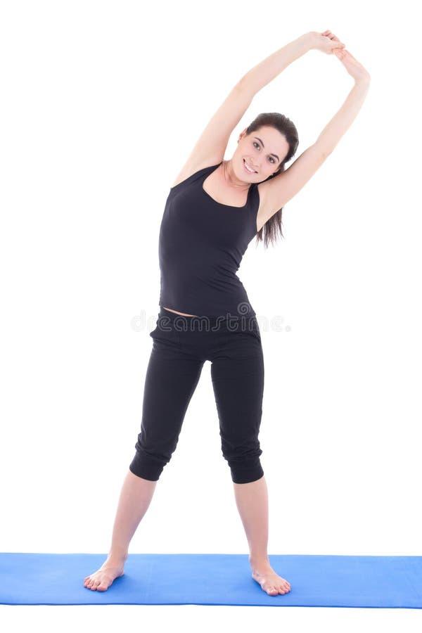做健身锻炼的年轻可爱的妇女隔绝在白色 库存图片