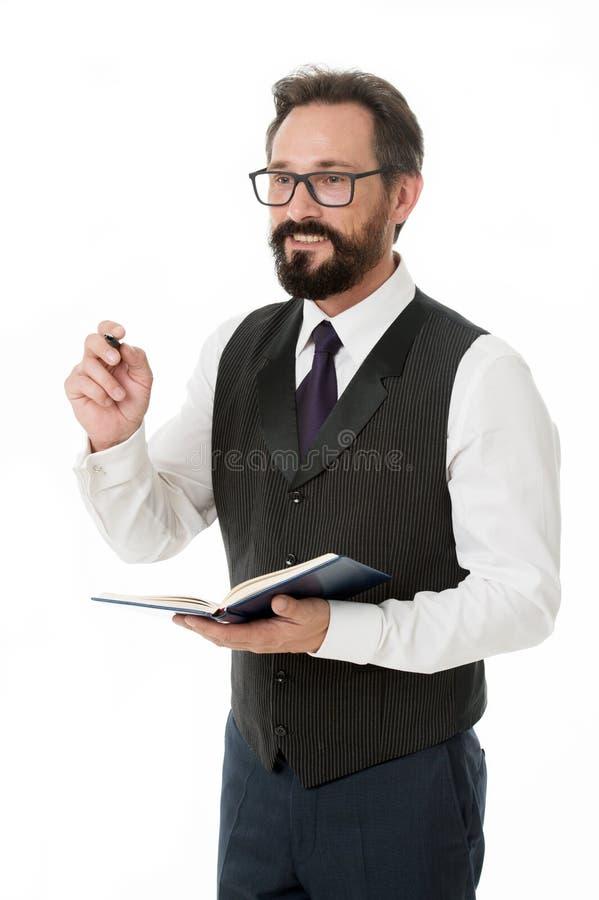 做名单商人计划与笔记薄的企业日程表 时间安排和组织的技巧 有胡子的人 免版税图库摄影