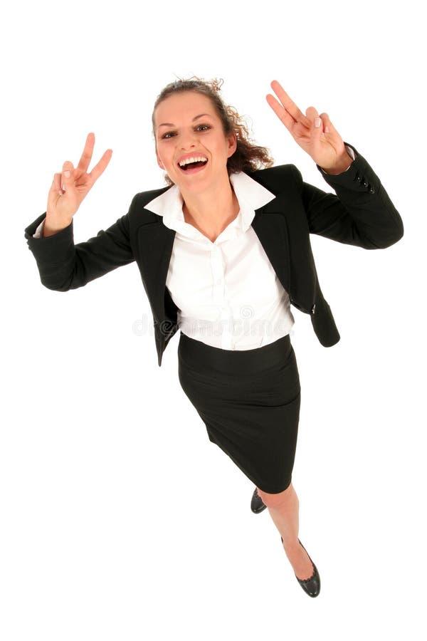 做和平标志的女实业家 库存图片