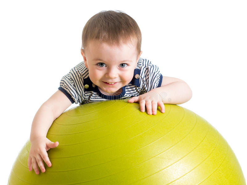 做在健身球的孩子健身锻炼 免版税库存图片