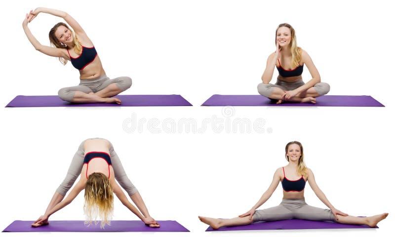 做在白色的年轻女性锻炼 免版税库存照片