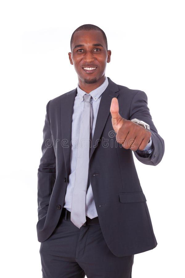 做在whi的非裔美国人的商人赞许姿态 免版税库存照片