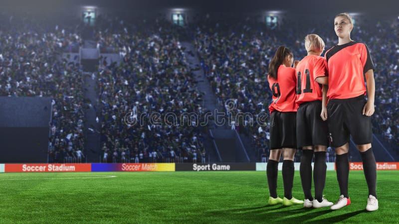 做墙壁的三位女性足球运动员在罚球前 免版税库存图片
