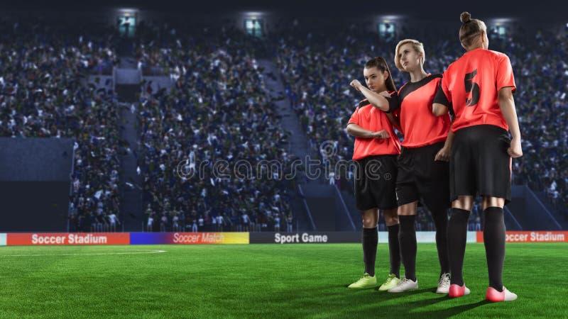做墙壁的三位女性足球运动员在罚球前 免版税库存照片