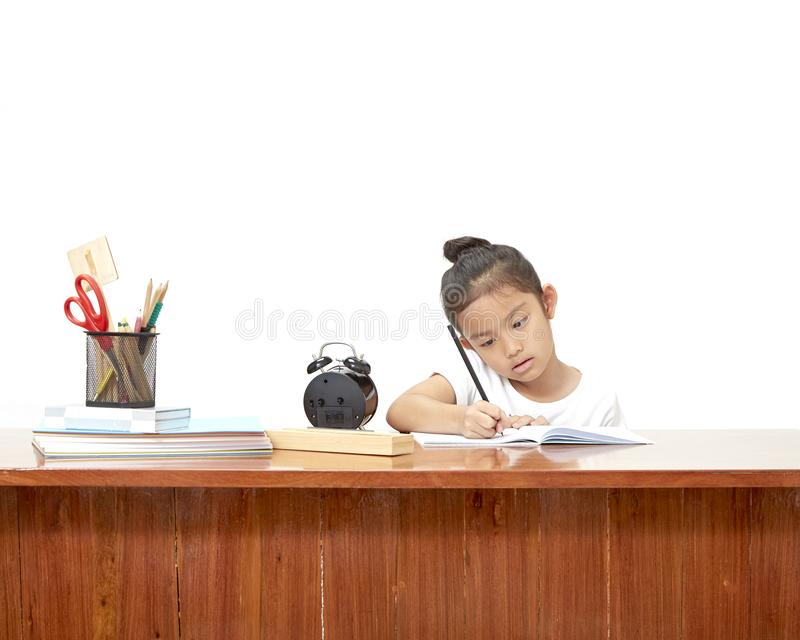 做她的家庭作业的亚裔小女孩 库存照片