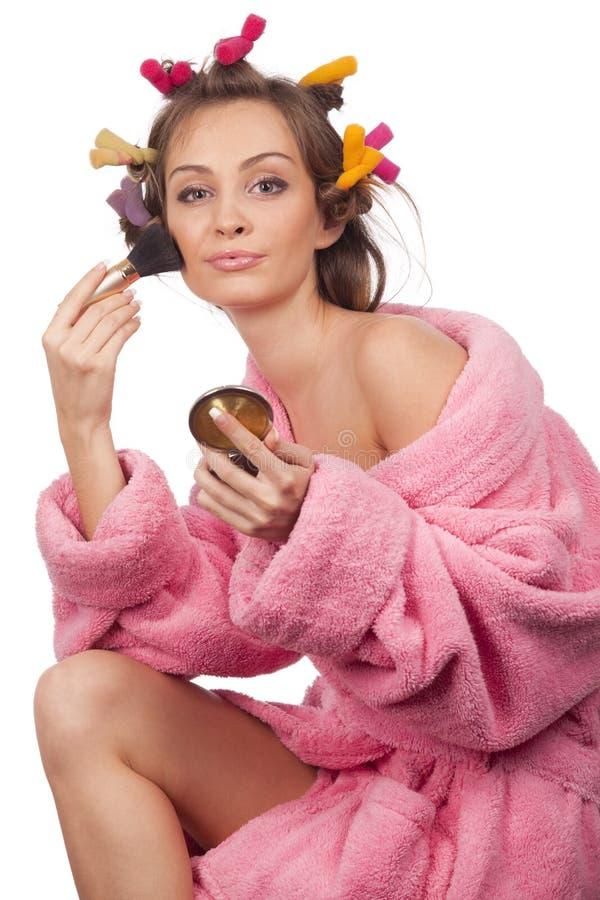 做妇女的浴桃红色长袍 图库摄影