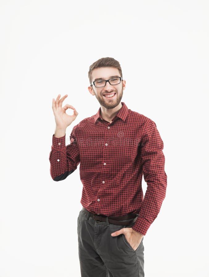 做姿态OK的成功的经理在白色背景 免版税库存照片